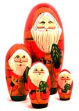 The Four Santas. Four wooden painted Christmas holiday nesting decorative toy doll figurines Stock Images
