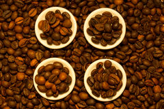 Four saucers full of fragrant coffee beans Royalty Free Stock Photo