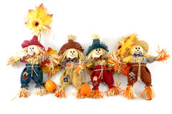 Four scarecrows Stock Images