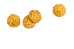 Four scattered ginger nuts in a row Royalty Free Stock Photo