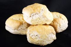 Four scones. Four fresh baked scones isolated on a black background Stock Image