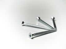 Four screws Stock Images