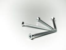 Four screws. Close-up image of four silver screws stock images