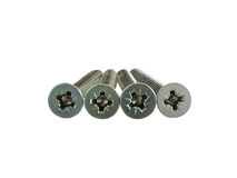 Four screws with flat cross head Royalty Free Stock Photos