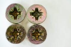 Four screws. Heads close up Royalty Free Stock Photos