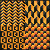 Four Seamless abstract geomatric pixel Halloween patterns. Zigzag, diamond, square and arrow style Royalty Free Stock Photo
