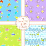 Four seamless kids patterns with funny cartoons. Royalty Free Stock Photos