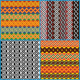 Four seamless ornaments on African ethnic motifs Royalty Free Stock Images