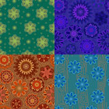 Four seamless pattern with decorative flowers. Blue, green, blue and orange.jpg. Four seamless pattern with flowers and dots of different colors Stock Images