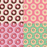 Four seamless patterns with colorful tasty glossy donuts Royalty Free Stock Images
