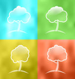 Four seasonal icons with trees Royalty Free Stock Photo