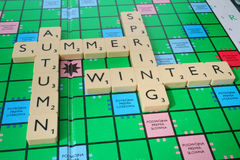 The four seasons. Four seasons of the year made of scrabble tiles Royalty Free Stock Photos