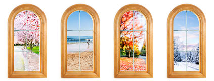 Four seasons. Round top window with Spring, Summer, Autumn and Winter views Stock Image