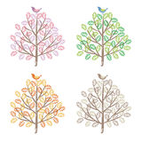Four seasons colorful trees and birds Stock Photos