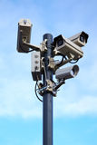 Four security cameras on blue sky Stock Photography