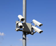 Four security cctc cameras mounted on metal post Stock Images