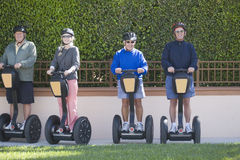 Four segway riders Royalty Free Stock Photography