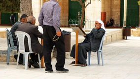 Four senior Muslims pray and read the Quran Stock Photography