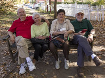 Four Senior sit on bench, West Cornwall overlooking Housatonic River, West Cornwall, Connecticut, USA October 18, 2016 Stock Photos