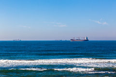 Four Ships Ocean Anchored Stock Photo