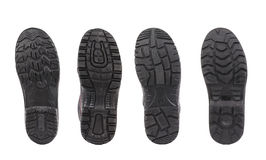 Four shoe soles in row. Royalty Free Stock Photos