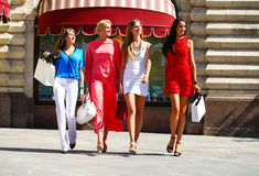Four shopping women walking at the red square in Moscow Royalty Free Stock Image