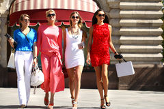 Four shopping women walking at the red square in Moscow Stock Images