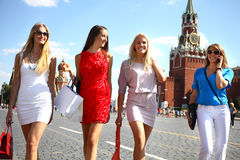 Four shopping women walking at the red square in Moscow Royalty Free Stock Photography