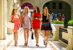 Four shopping women walking in shop Stock Photo