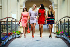 Four shopping women walking in shop Stock Images