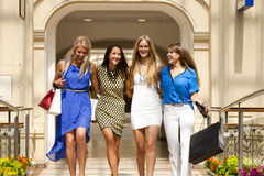Four shopping women walking in shop Royalty Free Stock Image