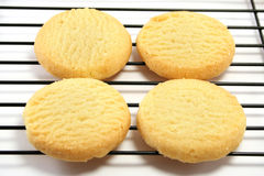Four Shortbreads on a cooling rack. Close up on four shortbread biscuits on a cooling rack royalty free stock photos
