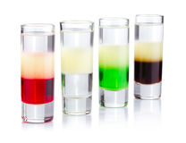 Four shot drink cocktails isolated on white Royalty Free Stock Photo