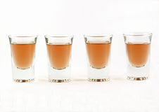 Four shot glasses Stock Photography