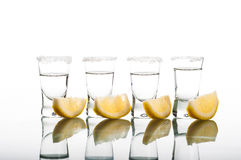 Four shots of vodka with lemon Royalty Free Stock Images