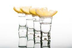 Four shots of vodka with lemon Stock Photo
