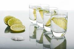 Four shots of vodka with lemon Stock Images
