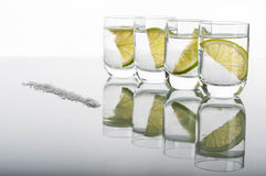 Four shots of vodka with lemon Royalty Free Stock Photo
