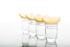Four shots of vodka with lemon Royalty Free Stock Image