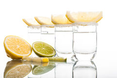 Four shots of vodka with lemon Stock Photography