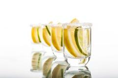 Four shots of vodka with lemon Stock Image