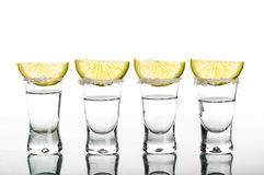 Four shots of vodka with lemon Royalty Free Stock Photos