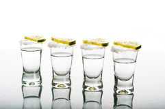Four shots of vodka with lemon Royalty Free Stock Photo