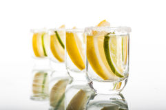 Four shots of vodka with lemon Royalty Free Stock Photography