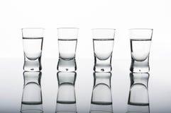 Four shots of vodka Stock Images