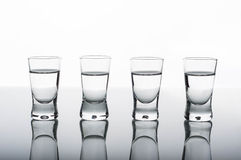 Four shots of vodka Royalty Free Stock Photography