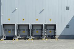 Four shutter doors at a warehouse Stock Images