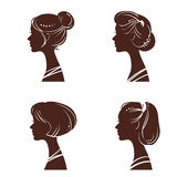Four silhouettes of women Stock Photography