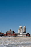 Four silo farm in winter. Vermont dairy farm, with 4 silos, in winter.  Vertical, with room for copy Stock Photos