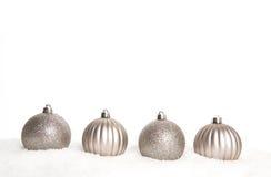 Four silver Christmas decoration balls Stock Photo
